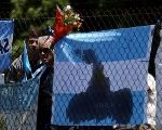 A bouquet of flowers and banners in support of the 44 crew members of Argentina's missing ARA San Juan submarine.