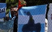 A bouquet of flowers and banners in support of the 44 crew members of Argentina