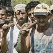 Brazilian slave laborers stop their work to listen to a Labor Ministry inspector explain their legal rights.