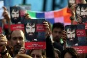 Protesters hold portraits of Santiago Maldonado, the young artist who drowned after being arrested at a Mapuche demonstration in August.