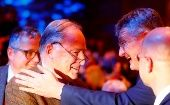 Jorg Meuthen (R) congratulates Alexander Gauland during the Alternative for Germany (AfD) congress in Hanover.