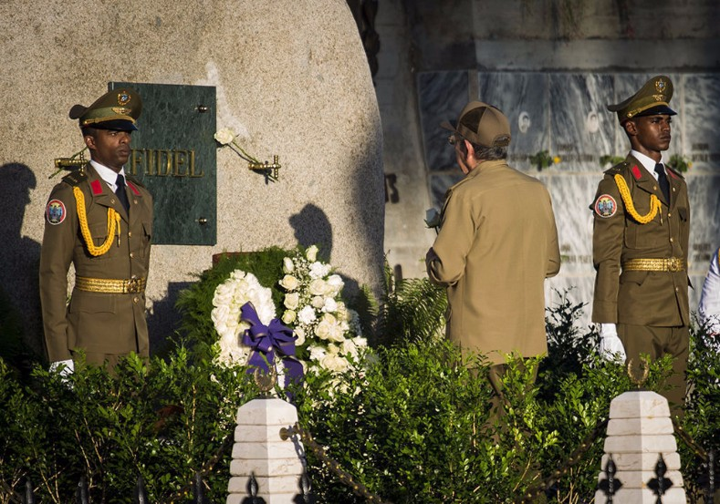 Cuban President Raul Castro salutes before the resting place of his brother and co-revolutionary.