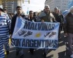 Argentines march with banner thats reads,