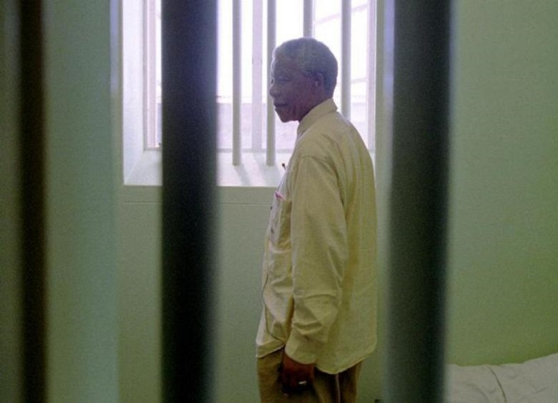 Mandela stares out of the window of the prison cell he occupied on Robben Island for much of his 27 year incarceration, February 11, 1994.