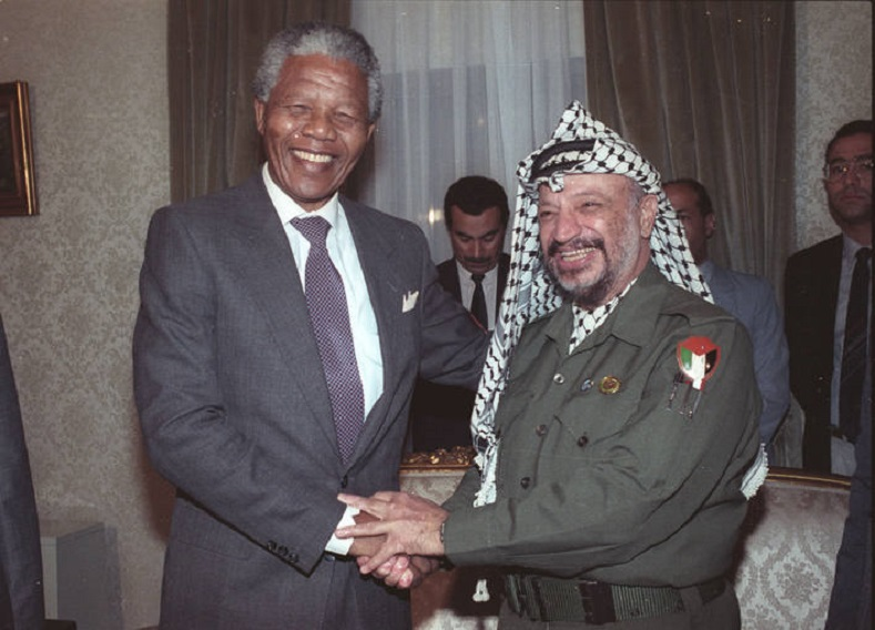 Mandela and Yasser Arafat greet each other in Cairo, 1990.