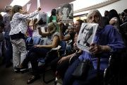 People hold portraits of those who disappeared during Argentina's military dictatorship.