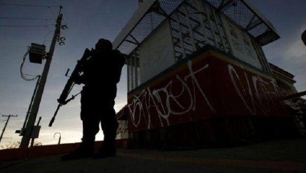 A soldier stands guard on a street in the neighbourhood of Nezahualcoyotl in Mexico City.