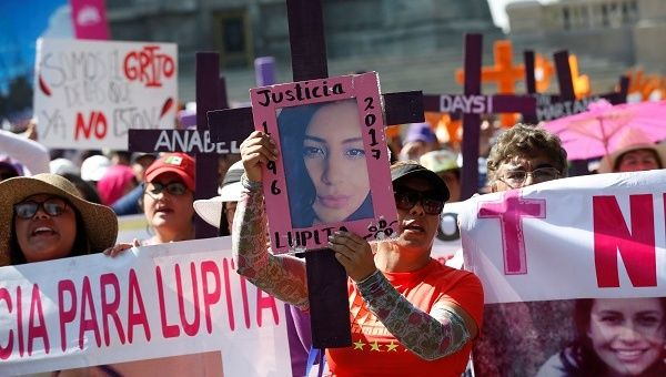 Relatives of women who were either murdered or disappeared take part in a march on International Day for the Elimination of Violence Against Women, in Mexico.