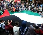 Students hold a Palestinian flag inside the Ain el-Hilweh refugee camp near Sidon, southern Lebanon, December 6, 2017.