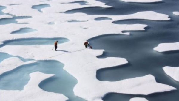 The crew of the U.S. Coast Guard Cutter Healy, in the midst of their ICESCAPE mission, retrieves supplies in the Arctic Ocean in this July 12, 2011 NASA handout photo.