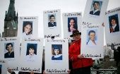 Demonstrators hold portraits of victims of the Montreal Massacre during the National Day of Remembrance and Action on Violence Against Women in Ottawa, December 2011.