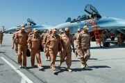 A handout picture taken on June 18, 2016 and provided by the Russian Defense Ministry shows Defense Minister Sergei Shoigu (C) visiting Russia's air base in Hmeimim in the Syrian coastal province of Latakia.