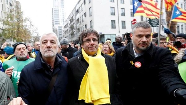 Ousted Catalan leader Carles Puigdemont takes part in a pro-independence rally in Brussels, Belgium.