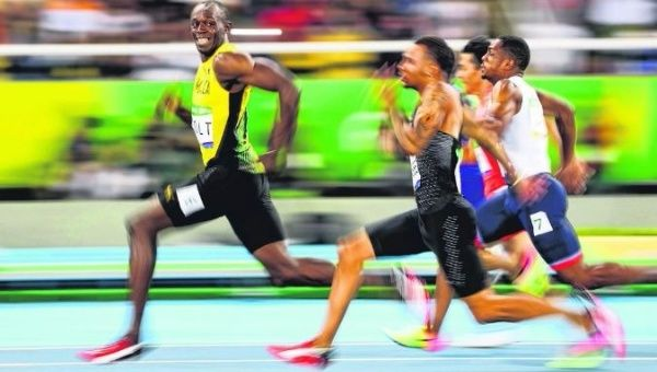 Usain Bolt en route to taking first place.