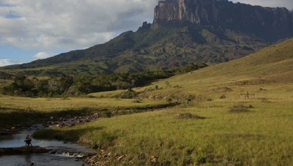 Above, travellers bathe in a stream at the foot of the Mount Roraima, Venezuela.