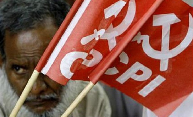 A member of the Communist Party of India hoists a banner in New Delhi.
