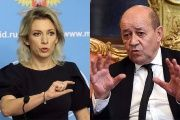 Russian Foreign Ministry Spokeswoman Maria Zakharova (L) and French Foreign Minister Jean-Yves Le Drian (R)