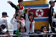 North Korean children wave during their tour on the Yalu River in Sinuiju, near the Chinese border city of Dandong, May 8, 2016.