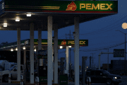 Clients get fuel at a gas station of state-owned company Petroleos Mexicanos (Pemex), in Ciudad Juarez, Mexico October 4, 2017.