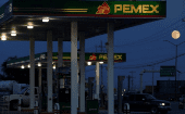 Clients get fuel at a gas station of state-owned company Petroleos Mexicanos (PEMEX), in Ciudad Juarez, Mexico October 4, 2017