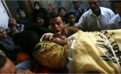Relatives of Fayez al-Ferai, 20, mourned during his funeral on Monday after Israeli forces shot dead four Palestinians off Gaza.