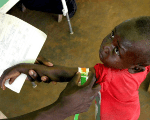 A Congolese boy has his arm measured for malnutrition in a clinic, March 18, 2006.