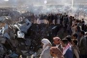 People gather at the site of an airstrike in Yemen's northwestern city of Sa'dah in November.
