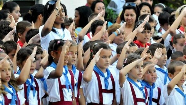 Cuban students salute the flag and sing the national anthem, September 5, 2011.