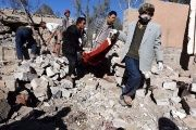 Yemenis remove corpses after Saudi-led airstrikes.