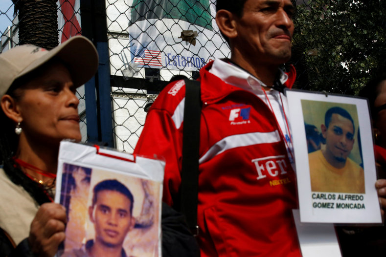 """Migrants are international workers,"" the protesters chant holding portraits of their missing children."