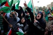 Palestinian women chant slogans during the rally.