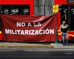 Activists hold a protest against a law that militarizes crime fighting in the country outside the Senate in Mexico City, Mexico December 14, 2017.