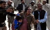 A police man directs families to safety following the terrifying attack in Bethel Memorial Methodist Church in Quetta, Pakistan Dec. 17.