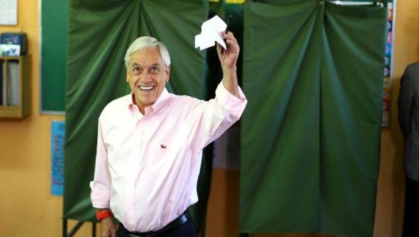 Chilean presidential candidate Sebastian Pinera shows his ballot during the presidential election in Santiago, Chile December 17, 2017.