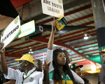 ANC members hold placards at the 54th National Conference of the ruling African National Congress (ANC) at the Nasrec Expo Centre in Johannesburg, South Africa December 17, 2017.