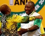 Deputy president of South Africa Cyril Ramaphosa greets an ANC member during the 54th National Conference of the ruling African National Congress, ANC, at the Nasrec Expo Centre in Johannesburg, South Africa December 18, 2017. REUTERS/Siphiwe Sibeko