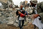A man carries Buthaina Muhammad Mansour, rescued from the site of a Saudi-led air strike that killed eight of her family members in Sana'a.