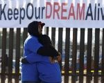 'Dreamers' hug as they meet with relatives during the 'Keep Our Dream Alive' binational meeting at the U.S.-Mexico border in Sunland Park, U.S., Dec. 10, 2017.