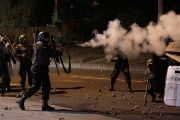 Police fire tear gas towards opposition supporters during a protest after Honduras' President Juan Orlando Hernandez declared himself re-elected.