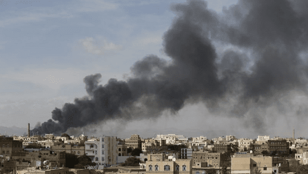 Smoke billows from a site hit by Saudi-led air strikes in Yemen