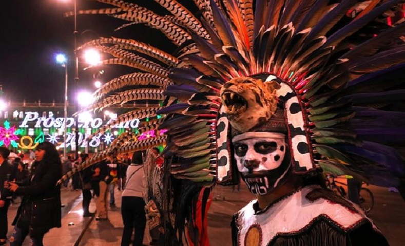 Mexicans dress up in creative costumes for tourists, blending the present with the past as culture meets Christmas in the heart of Mexico City