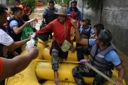 Rescuers evacuate residents during heavy flooding in Cagayan de Oro city in the Philippines, Dec. 22, 2017.