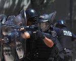 Police officers take aim at demonstrators during pension reform protests in Argentina on December 18.