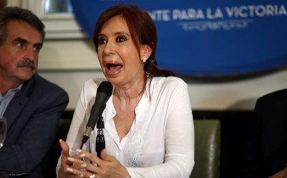 Former Argentine President and Senator Cristina Fernandez de Kirchner speaks next to lawmaker Agustin Rossi during a news conference at the Congress in Buenos Aires, December 7, 2017. Picture taken December 7, 2017.