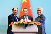 Afghan Foreign Minister Salahuddin Rabbani (L), Chinese Foreign Minister Wang Yi (C) and Pakistani Foreign Minister Khawaja Asif (R).