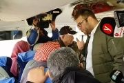 Israeli lawmaker Oren Hazan yells at Palestinian families of prisoners while on their way to visit them in an Israeli jail.