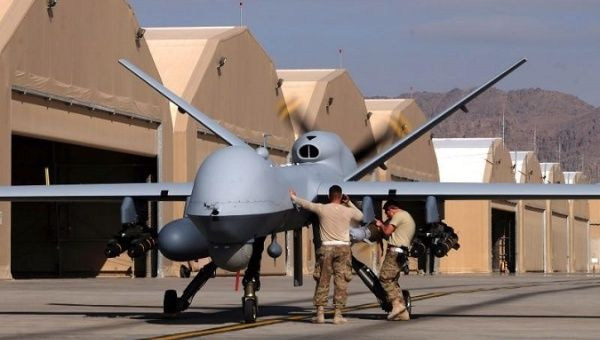 U.S. airmen prepare a U.S. Air Force MQ-9 Reaper drone as it leaves on a mission at Kandahar Air Field, Afghanistan March 9, 2016.