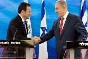 Guatemalan President Jimmy Morales and Israeli Prime Minister Benjamin Netanyahu shake hands as they deliver statements to the media during their meeting in Jerusalem November 29, 2016.