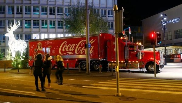 A Coca-Cola Christmas truck, similar to those cruising the UK this year, stands in front of a shopping mall in Zurich.
