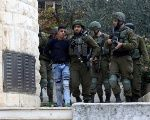A young Palestinian boy is arrested by Israeli forces near Nablus.